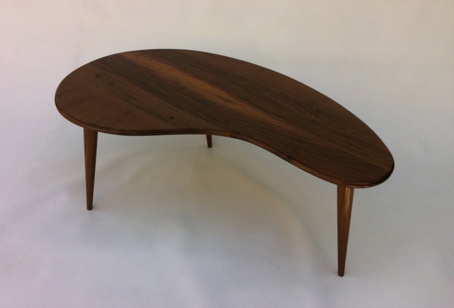 mid century modern walnut coffee table with tapered legs